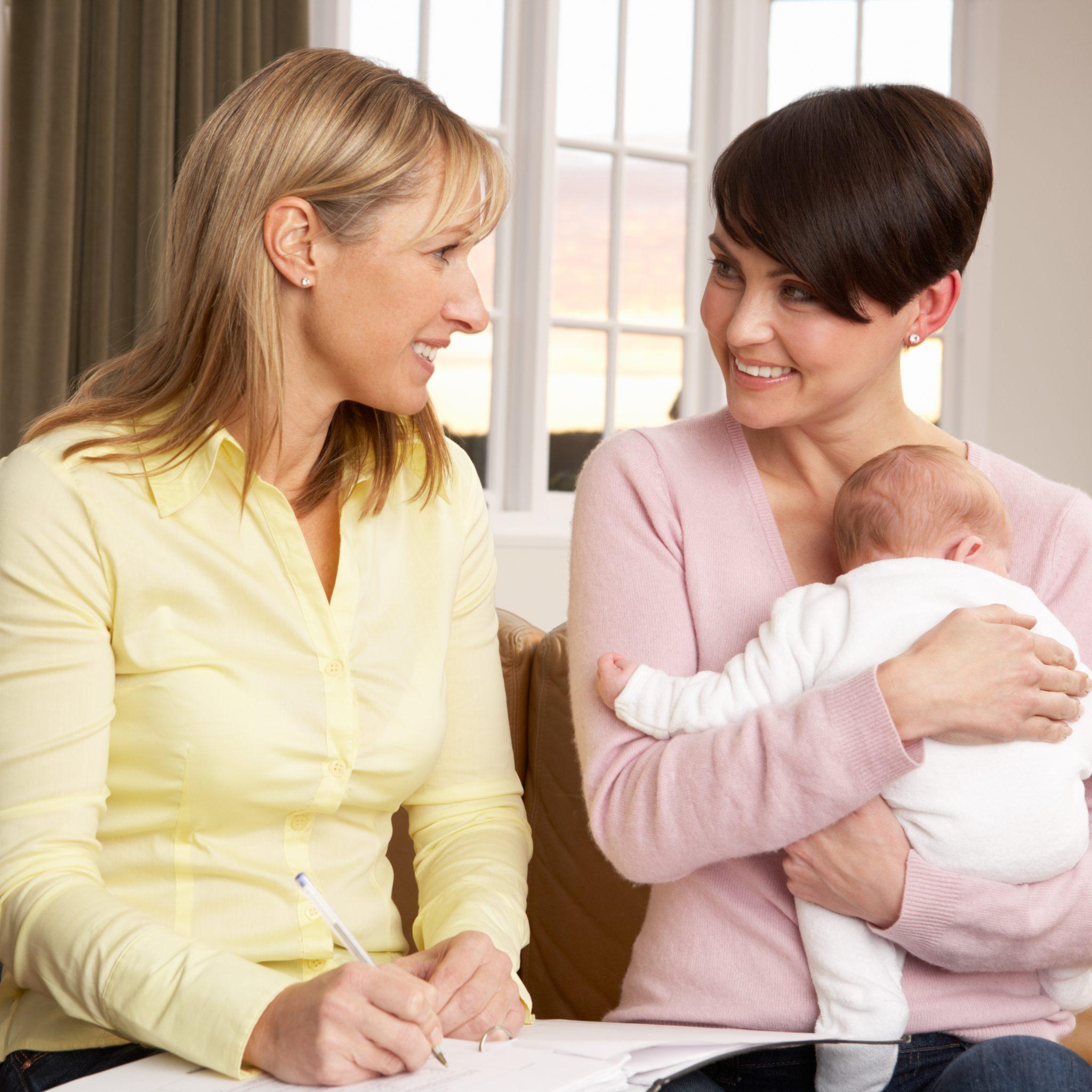 bigstock-Mother-With-Newborn-Baby-Talki-17604917